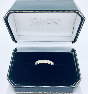 18K white gold channel set eternity band