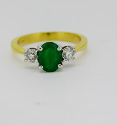 three stone green emerald ring with round diamonds